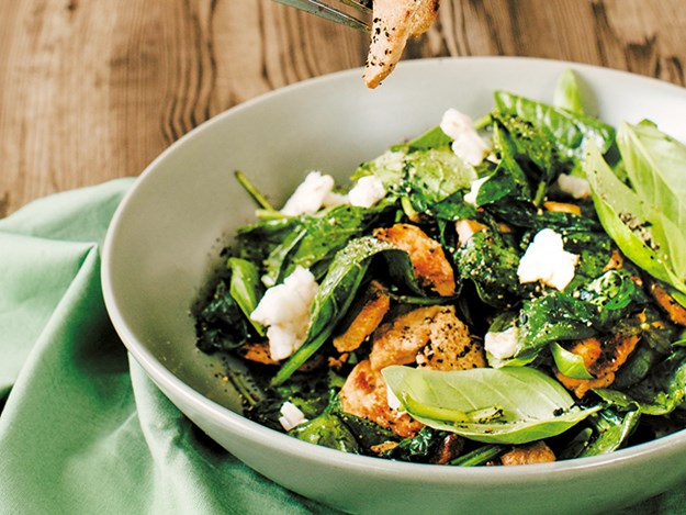 Stir-fried chicken and basil salad on just-wilted spinach.jpg