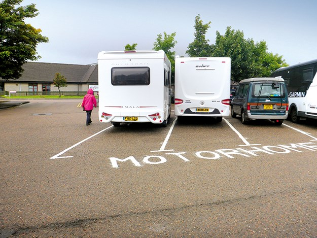 Tight parking at Fort William in Scotland
