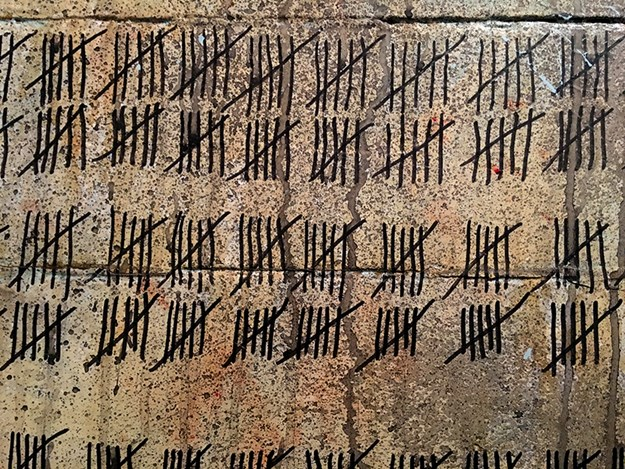 Prisoner graffiti, counting the days