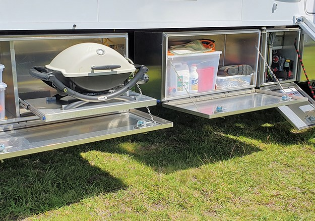 Outside, there's plenty of storage including a dedicated locker for the Weber BBQ