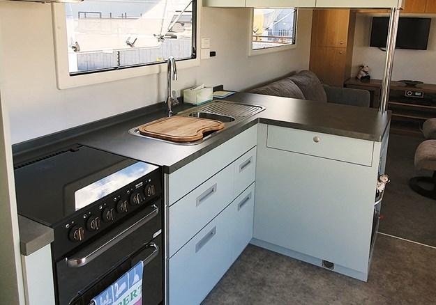 The kitchen has plenty of storage space.jpgE