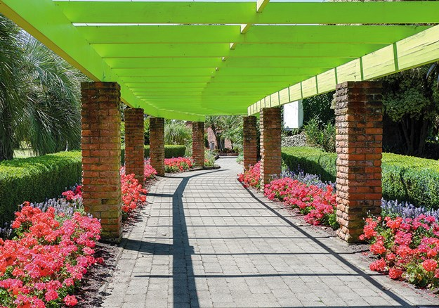 A brightly coloured walkway leads to the Homestead Garden