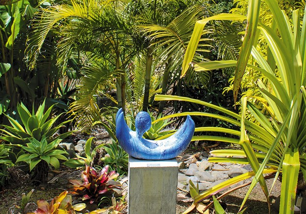 Ceramic art by Ivan Vostinar(above and below) provides a pop of colour amongst the greenery at Paloma