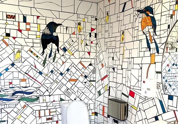 Tiled artwork lines the new toilets.jpg