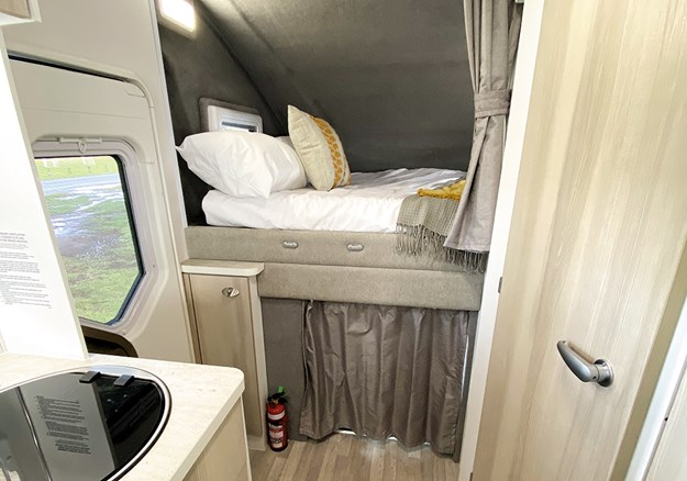 The comfy bed is located over the cab