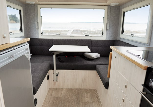 The rear lounge has enough space to seat six with expansive window views