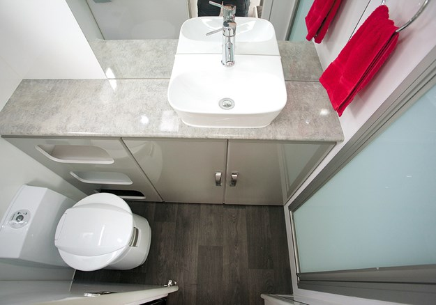 The bathroom is compact but practical