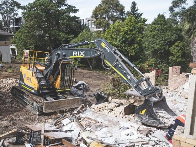 The Hyundai R145CRD-9 excavator demolishing houses