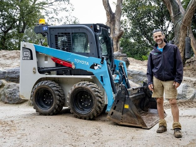 The Toyota Huski 5SDK8 skid steer loader is busy building enrichment for elephants at Melbourne Zoo