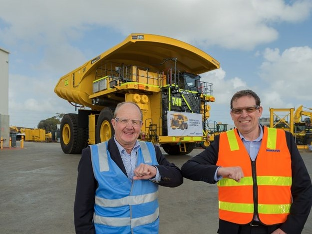 Glen Swift, Komatsu's General Manager, Western Region (right) hands over the keys of one of the first five Komatsu 830E-5 sold in Australia to Downer Group's Andrew Haslam, General Manager - Open Cut West, Mining, with a COVID-safe elbow tap.
