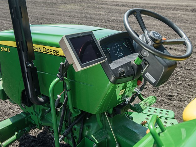 The 4240 Universal Display is an economical display for AutoTrac and documentation for open-station tractors