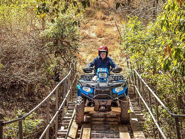 POLARIS SPORTSMAN 570 HD EPD going across the bridge