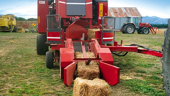Vertical rollers in the pick-up shoot grasp the sides of the bales lifting it into the machine