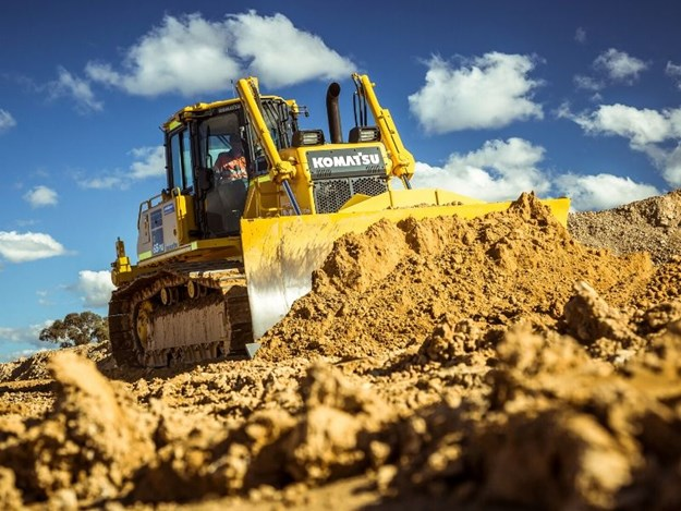 The Komatsu D65PXi-18 IMC intelligent dozer carving out the track