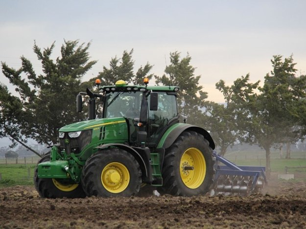 The John Deere 250R working hard in the field