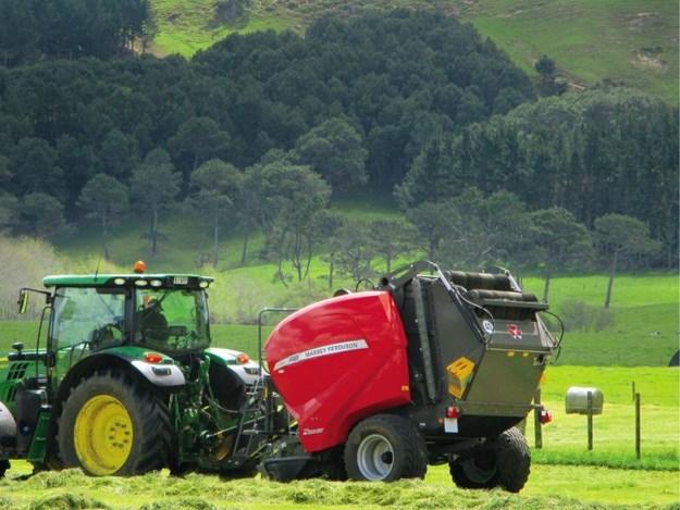 The Massey Ferguson Baler behind a John Deere tractor