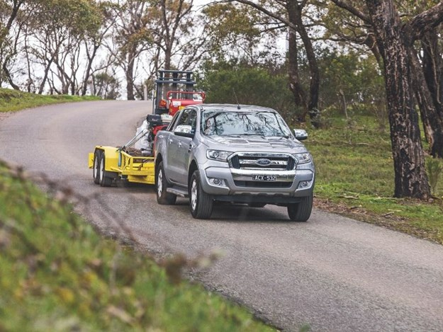 A Ford Ranger ute towing a trailer