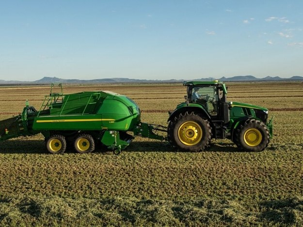 John Deere 8R with a baler behind