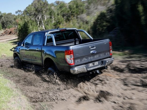 The Ford Ranger XLT going through the mud