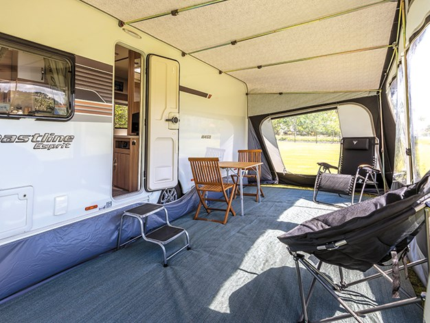 A large inflatable awning adds an extra room