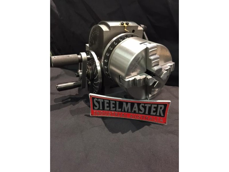 steelmaster semi universal dividing head bs-0-4c, comes with 3 & 4 jaw 100mm dia. chucks 701618 009