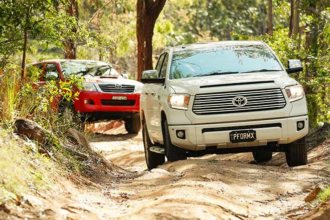 Toyota-Tundra-Crewmax-vs-Toyota-Hilux-SR5-double-cab-on-the-track