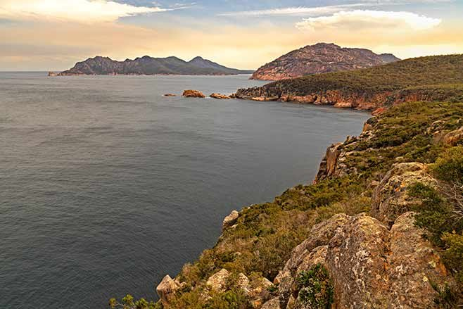 Coastline-from-Cape-Tourville-looking-back-towards-Mt-Dove-and-the-Freycinet-Peninsula