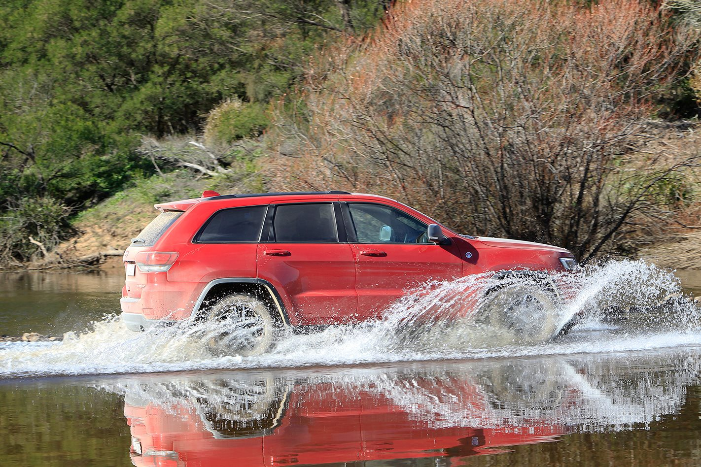 2017 Jeep Grand Cherokee Trailhawk driving through water.jpg