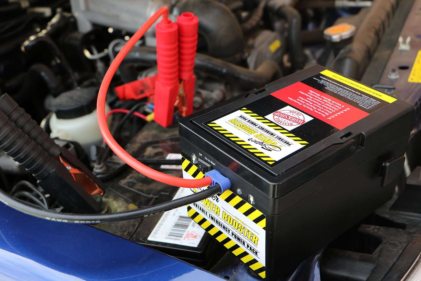 Super Power Booster battery charging a car