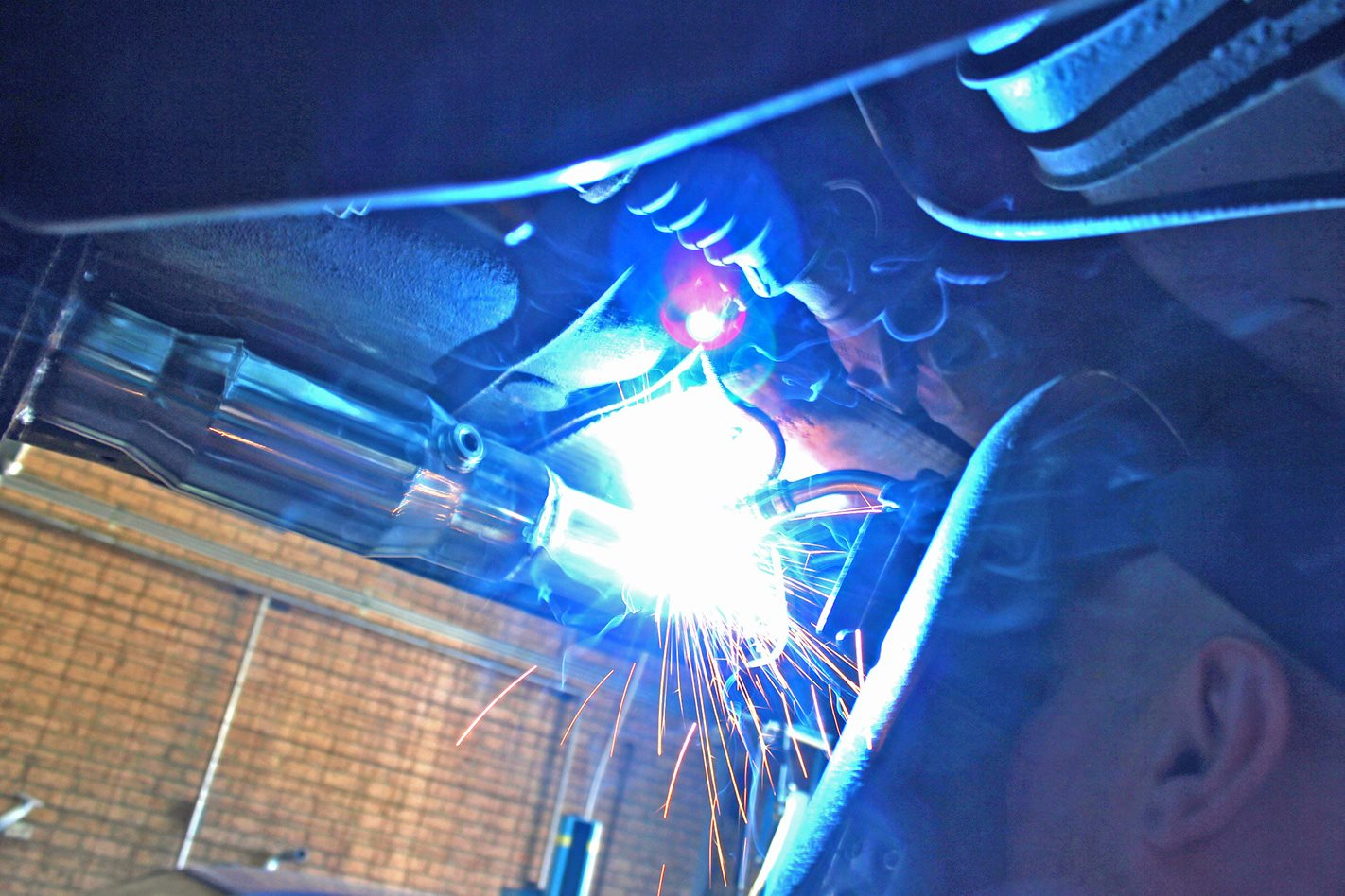 at is welded into place on the existing stainless-steel exhaust pipe
