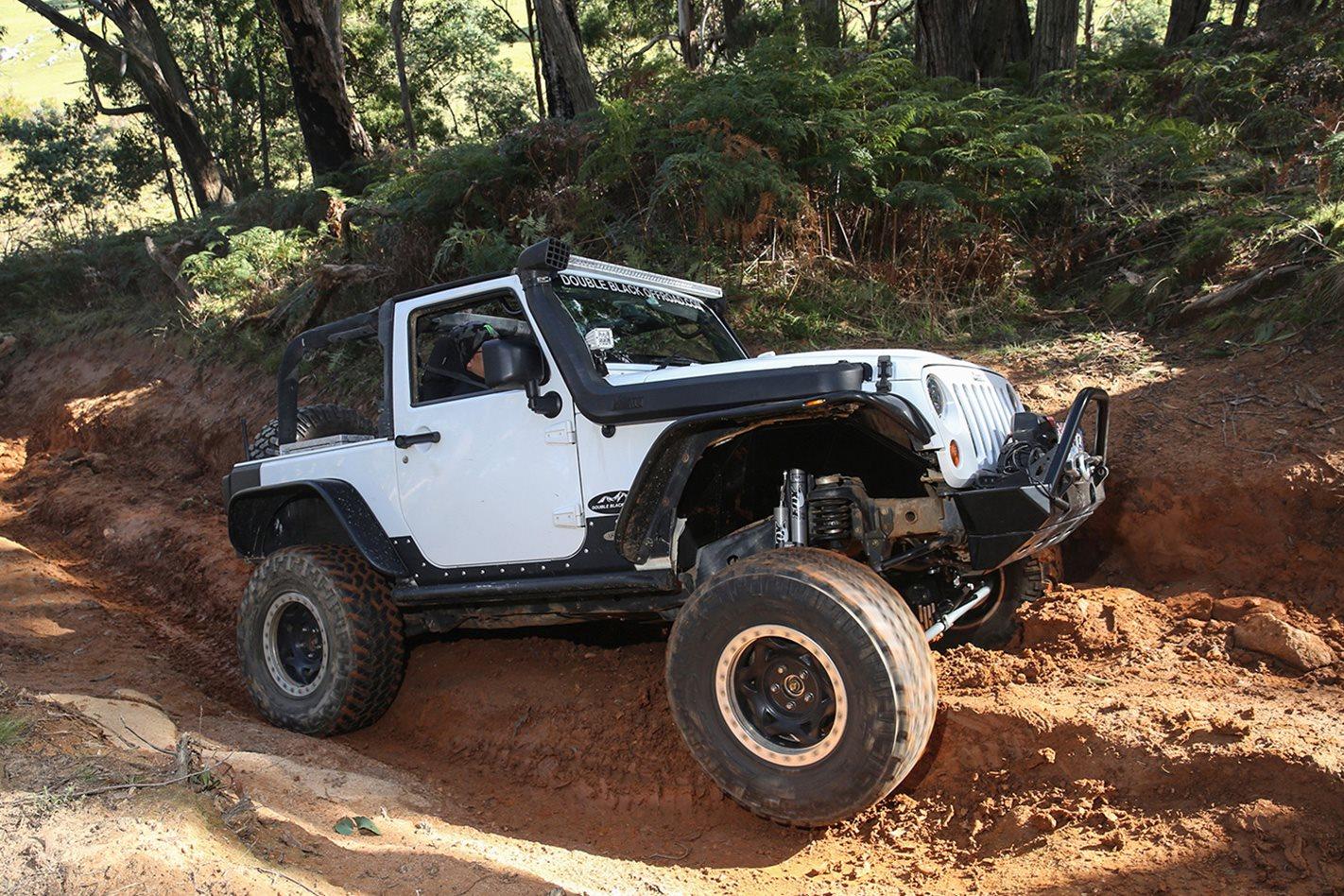 2013-Jeep-Wrangler-Rubicon-Double-Black-offroad-side.jpg