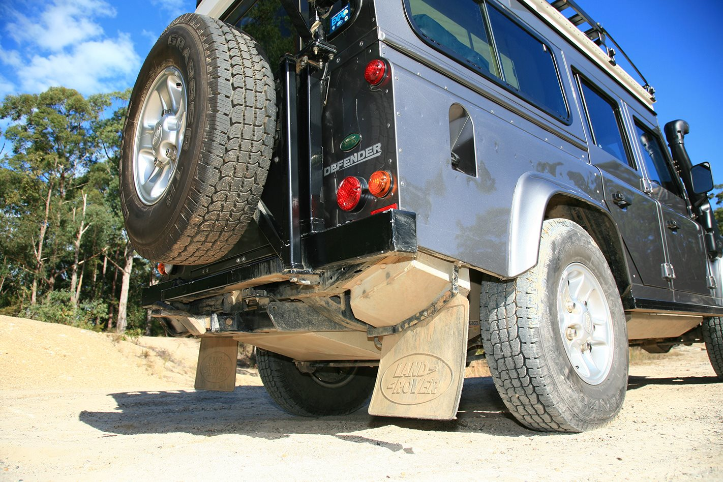 Land Rover Defender custom camper mud flaps.jpg