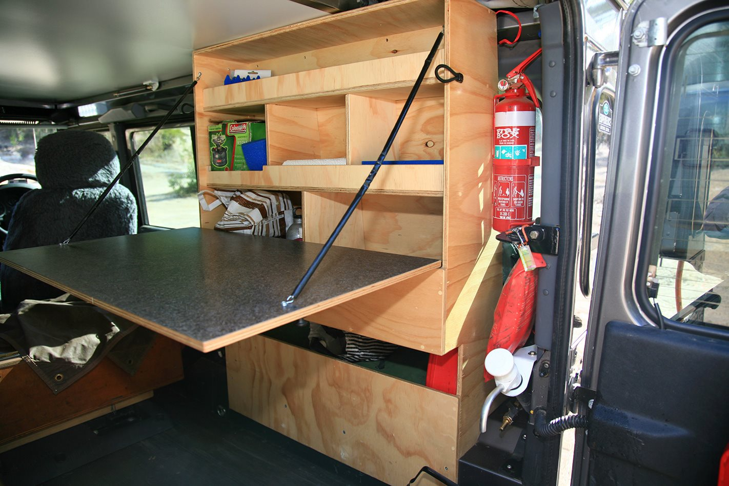 Land Rover Defender custom camper storage.jpg