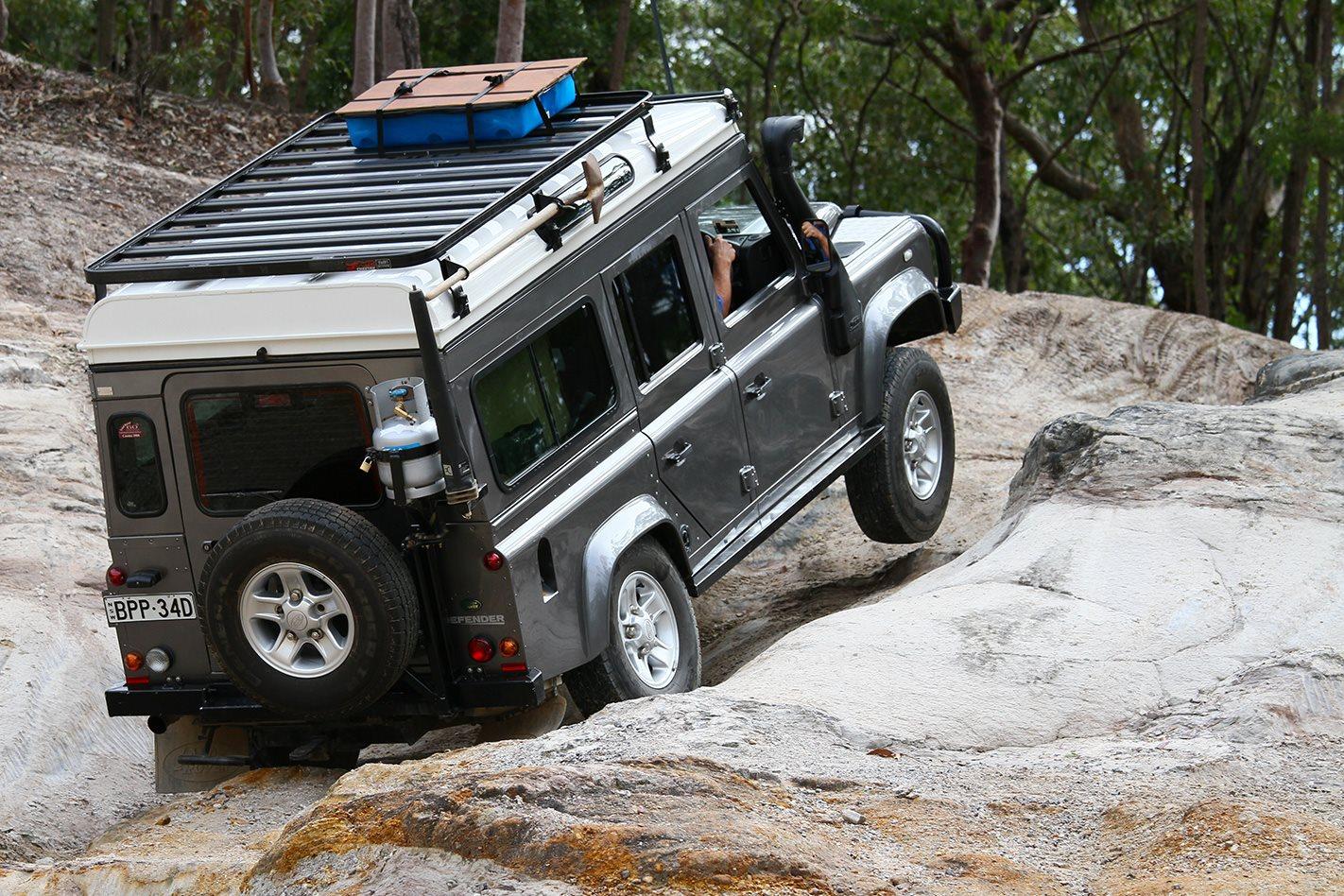 Land Rover Defender custom camper uphill.jpg