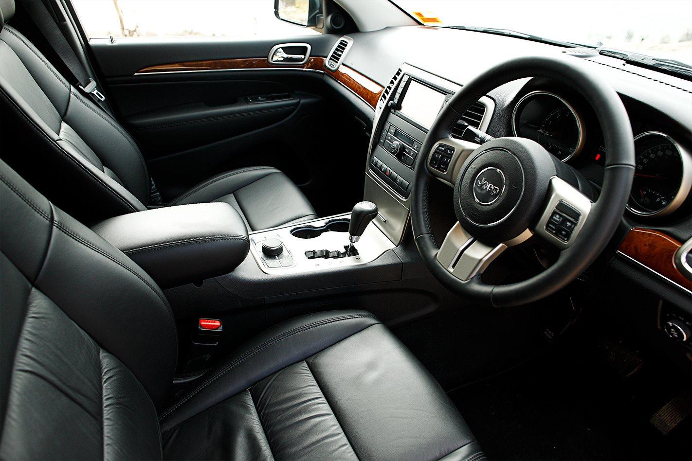 2011 toyota landcruiser 200 series vs land rover discovery 4 vs jeep grand cherokee comparison for 2011 grand cherokee interior