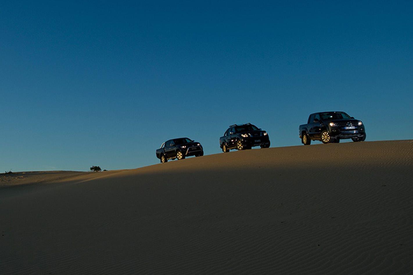 2011-Volkswagen-Amarok-vs-2011-Mitsubishi-Triton-vs-2011-Nissan-Navara-sand-driving.jpg