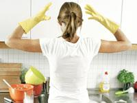 housewife in yellow gloves in kitchen