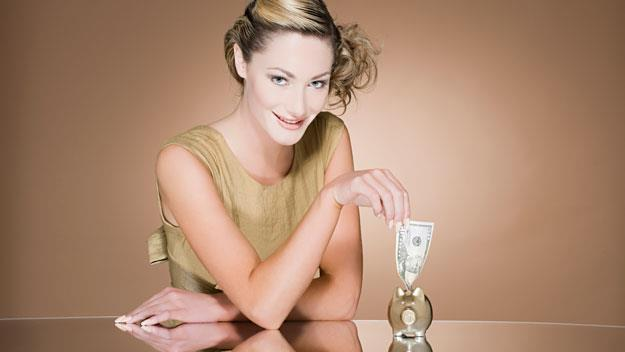 woman with cash, Getty Images