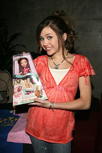 Miley with her Bratz doll in 2006.