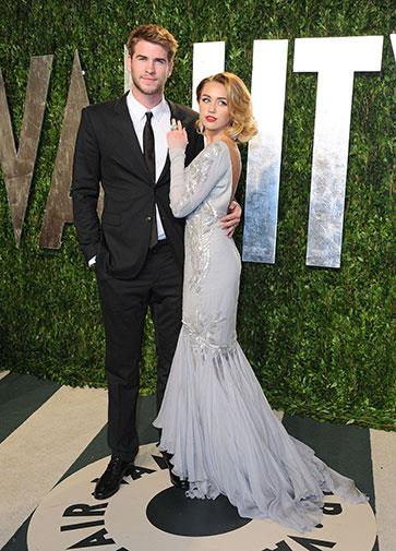 With fiance Liam Hemsworth at the 2012 Oscars.