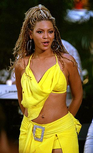 A skimpy and eye-wateringly bright yellow two-piece in May 2001.