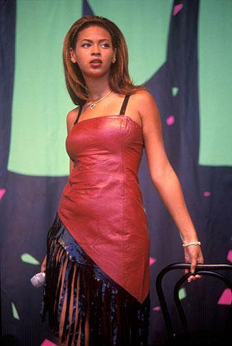 Leather, exposed bra straps and fringe in 1998.