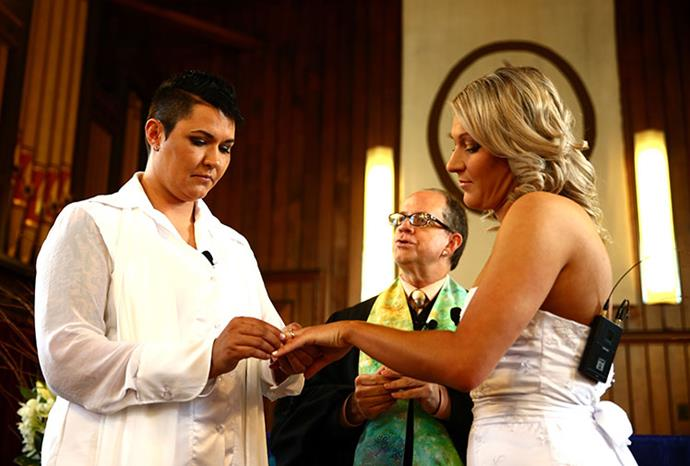 Natasha Vitali and Melissa Ray exchange rings.