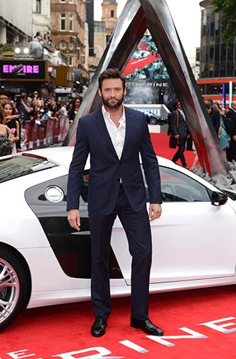 Hugh arrived in a flashy white sports car.