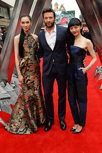 Hugh with his co-stars Rila Fukushima and Tao Okamoto.