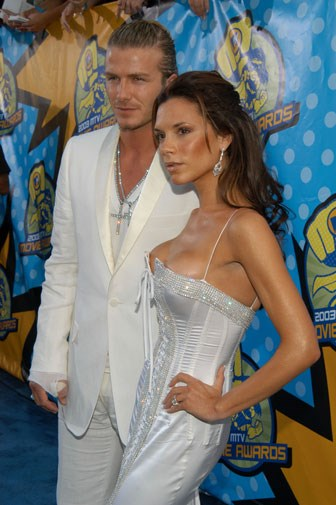 Matching white outfits in 2005.