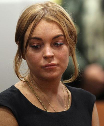 Lindsay looking miserable in court in January 2013.