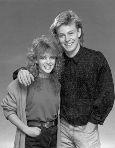 It was all about high-waisted jeans for Kylie. She is pictured with her Neighbours love interest Jason Donovan in 1987.