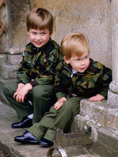 William and Harry looking up to mischief in matching camouflage outfits at Kensington Palace in 1986.
