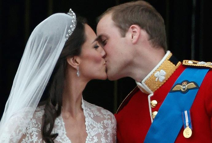 The couple kissing on their wedding day in April 2011.